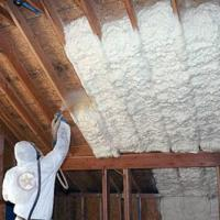 Worker Applying Spray Foam to New Construction Ceiling
