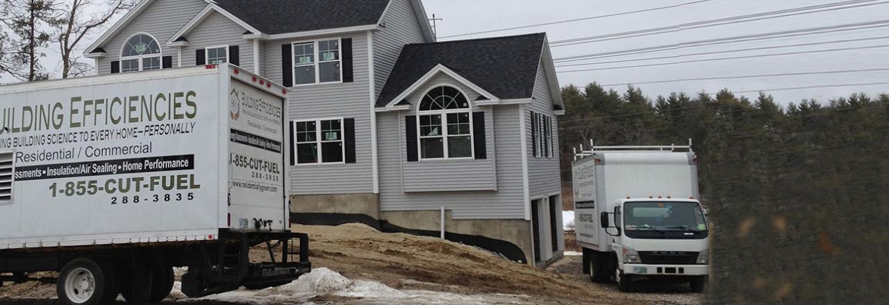Building Efficiencies Trucks In Front of House
