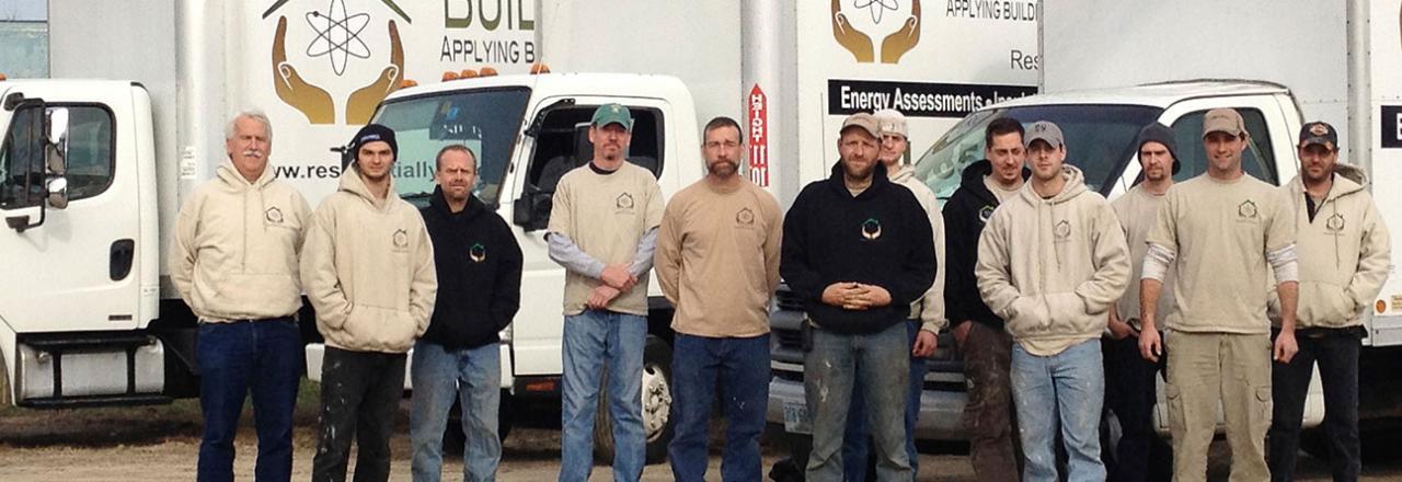 Building Efficiencies Team Standing In Front of Trucks