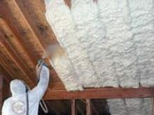 Spray Foam Applied By Worker on New Construction Ceiling